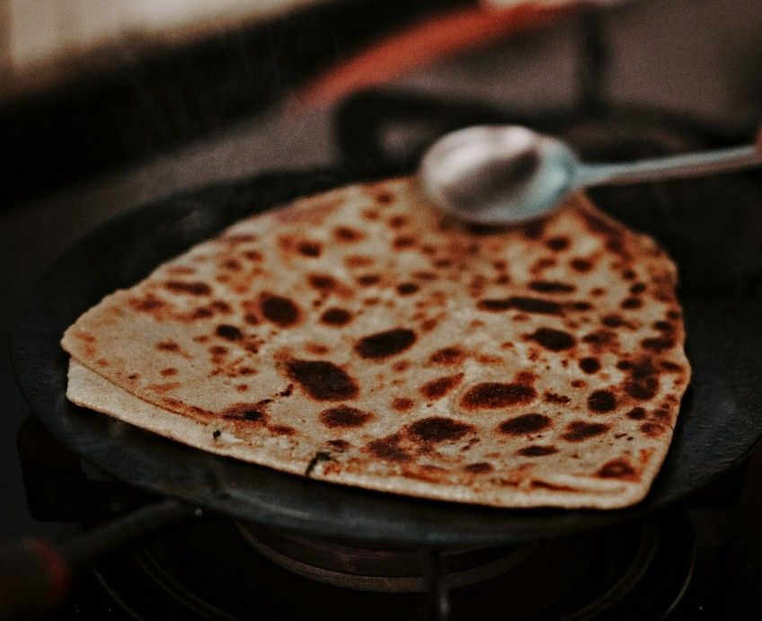 How to make Layered paratha or paratha or Tikona paratha?