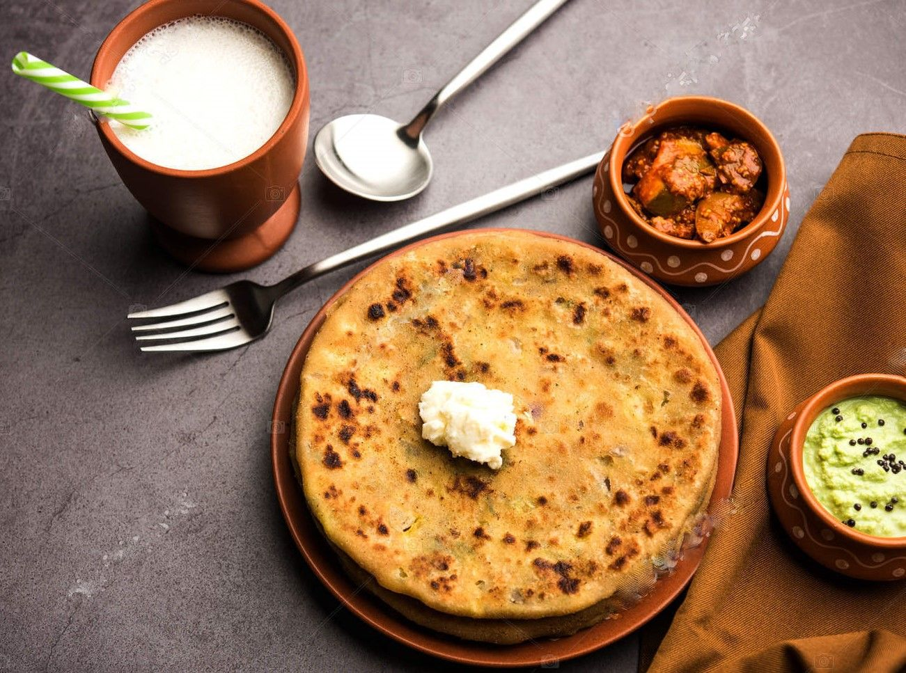 How to make tasty and healthier aloo paratha or aloo ka paratha or potato-filled and shallow fried chapati?